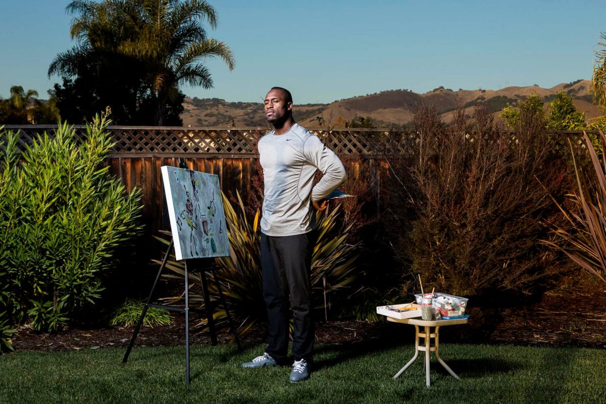 Professional football player, Vernon Davis, works on one of his paintings at home in the San Jose hills. Davis plays tight end for the San Francisco 49ers.
