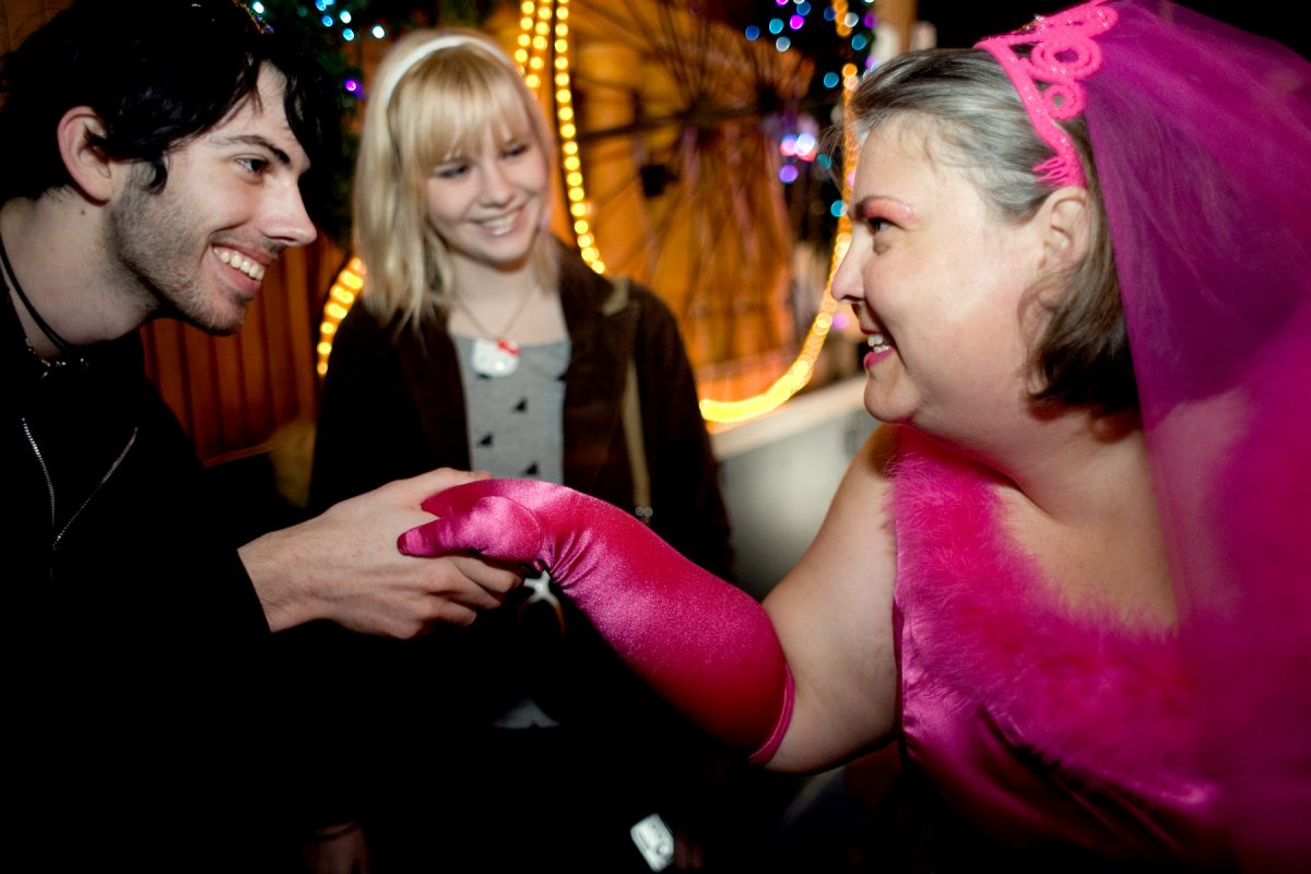 Wann meets newcomers during the 9th annual Brides of March event. The meeting place was Ginger's Trois, a legendary gay bar in San Francisco.
