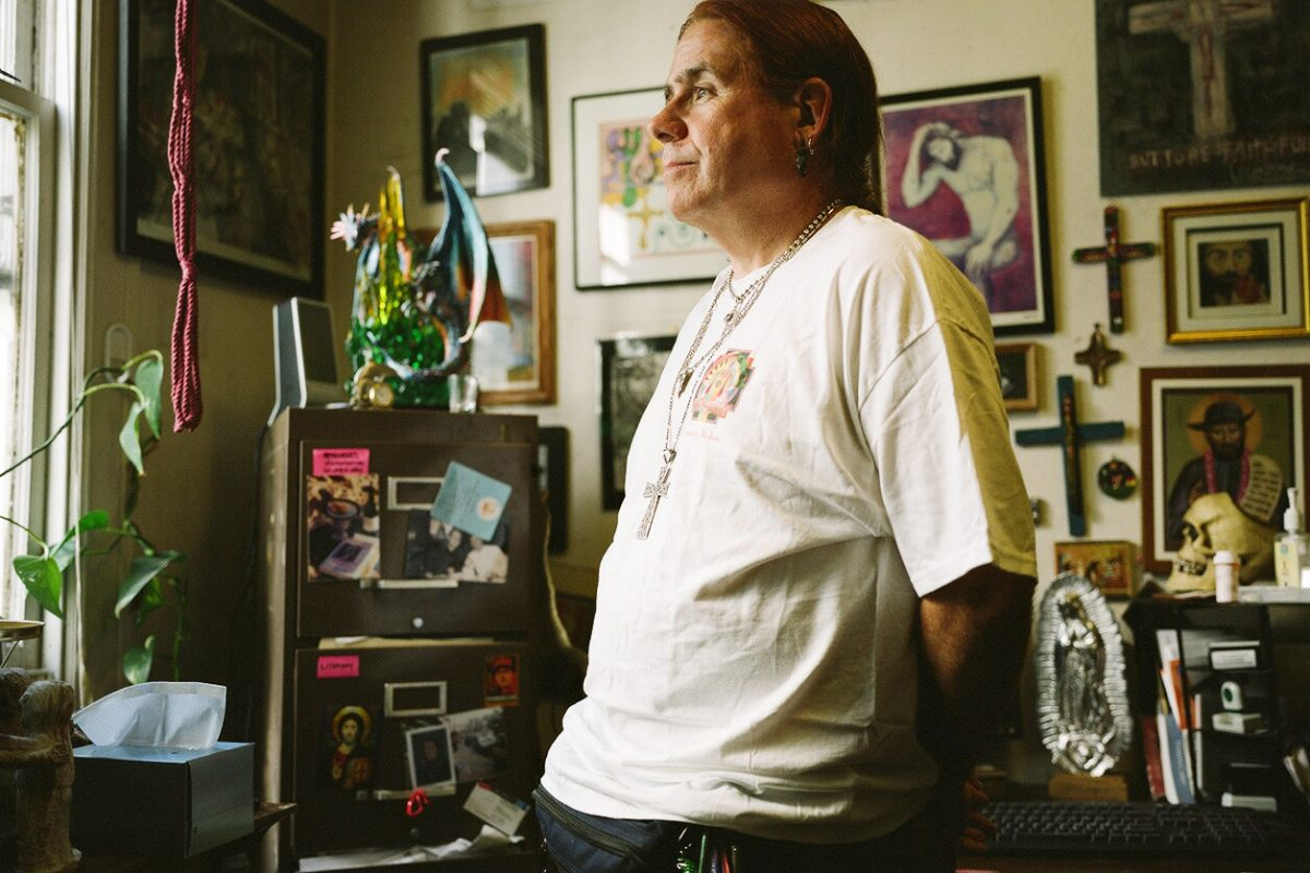 Rev. River Sims in his apartment on Polk Street.