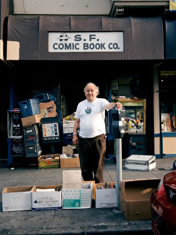 Gary is the owner of one of the very first comic book shops in the United States. His store, the SF Comic Book Shop has been on Mission and 23rd St. over 30 years. No more than four people fit in the space where stacks and stacks of comic books are pilled on top of each other.