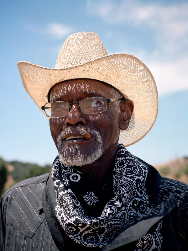 "Hayward, California. July 14, 2018. Retired racehorse groomer from Stockton, Robert ""Cowboy"" Armstead, age 72 is eager to keep Black cowboy history alive in the West. He trained, exercised and ponied horses since moving to California from Arkansas. ""They're just great animals,"" he said. ""I love horses. I would do anything in the world to be around them all the time."""