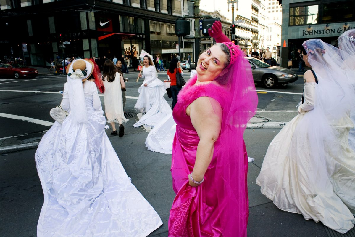 "Wann in her pink wedding dress during the 9th Annual Brides of March event. She is joined by hundreds of ""brides"" as they parade through San Francisco's Union Square in protest of the commercialization of weddings."