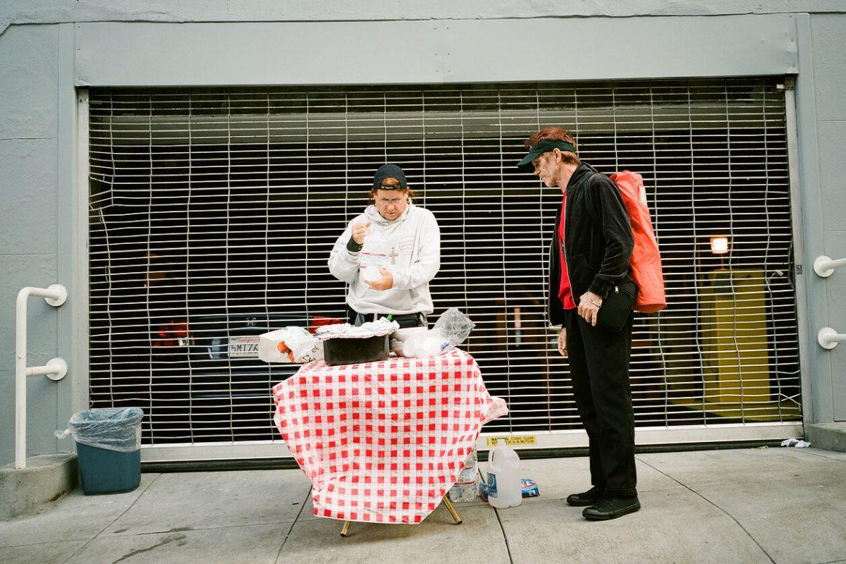 Rev. River Sims feeding the homeless on Hemlock Alley.