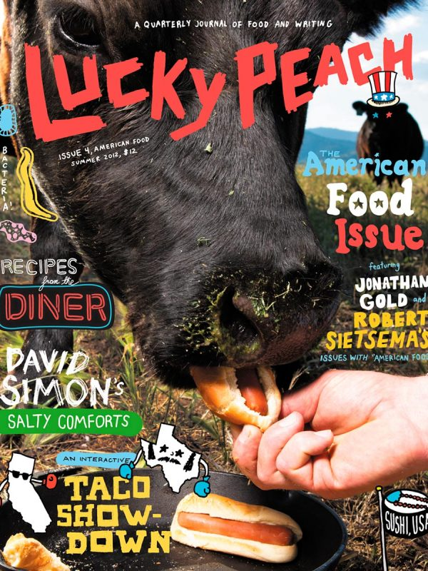 Cow eating veggie dogs for the cover of Lucky Peach. Shot at Belcampo Farms.