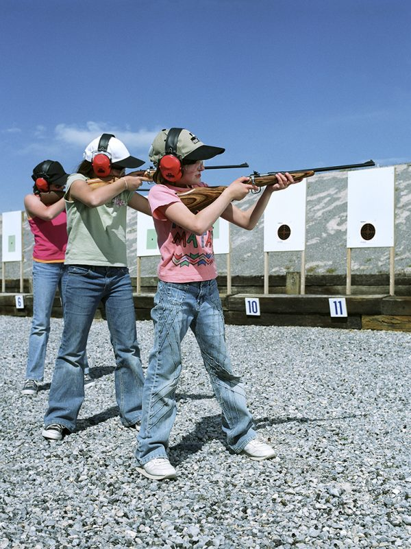 Pahrump, Nevada. April 16, 2005 Very young girls aim at a target during a self defense practice at a shooting range. Photograph by Gabriela Hasbun.