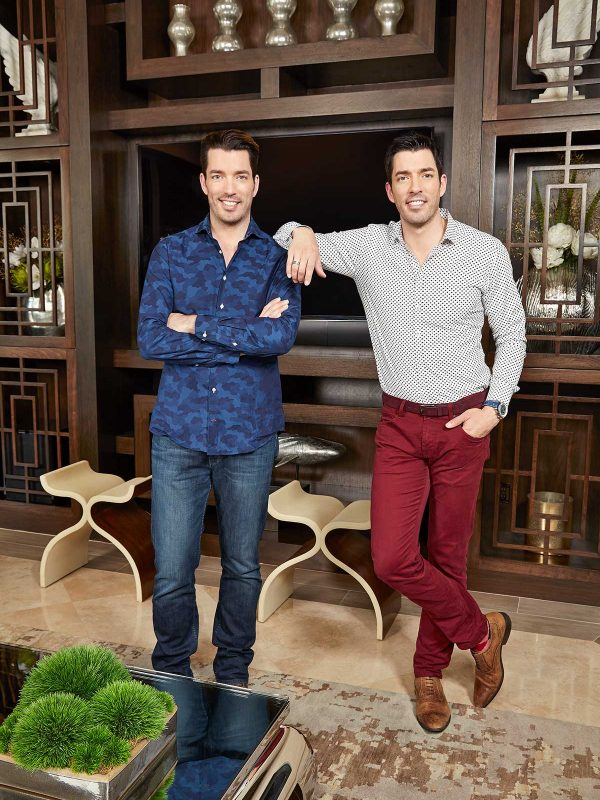 The Property Brothers Drew Scott (tie) & Jonathan Scott (blue shirt) photographed at home in Las Vegas, NV on September 19, 2014.  Photographer: Gabriela Hasbun Groomer: Zee Clemente/Zenobia Prop Stylist: Amy Villareale/Zenobia Stylist: Christie Moeller/Zenobia  (no clothing credits needed)