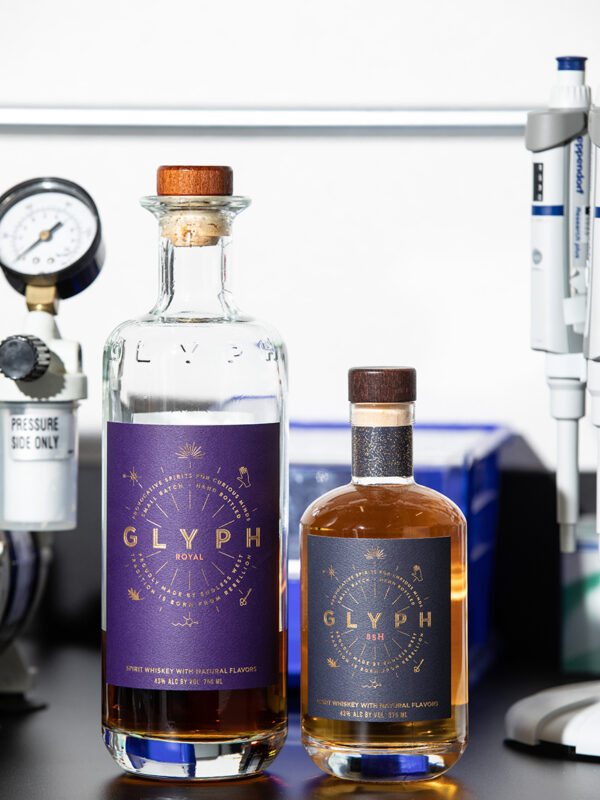 Glyph, right, the flagship whiskey from Endless West, is modeled after bourbon, while Glyph Royal is modeled after Scotch