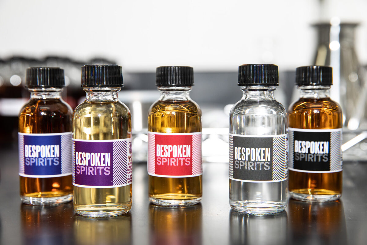 "Bespoken has several products on the market, including three kinds of whiskey and a dark rum. The clear bottle, second from right, is their ""source"" spirit.Credit..."