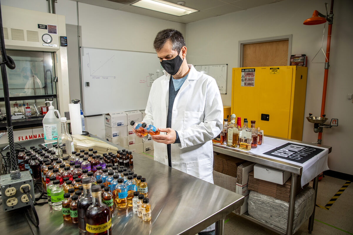 Stuart Aaron, a founder of Bespoken Spirits, with samples of some of the thousands of whiskeys his company has produced.