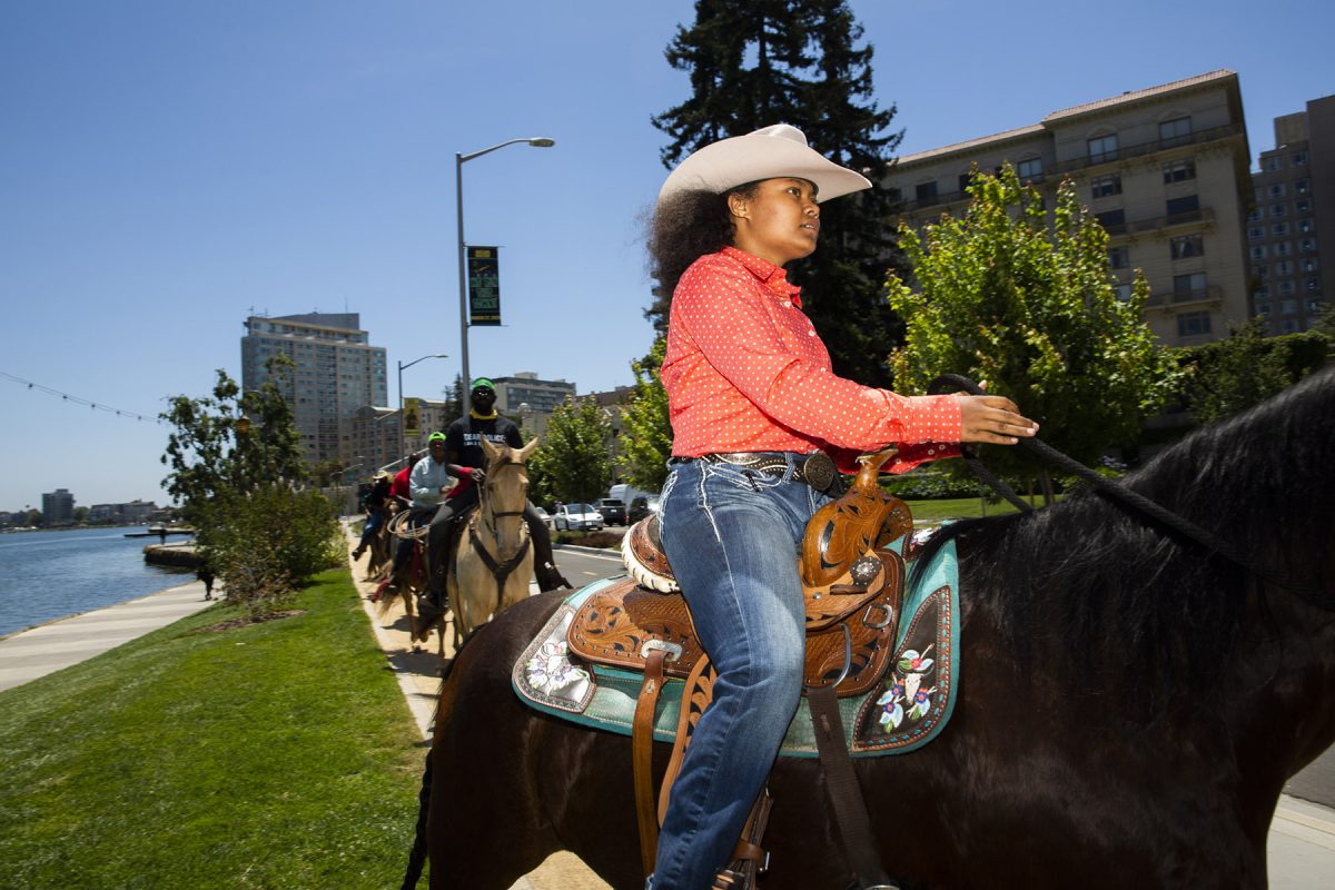 The black cowboys of Oakland ride peacefully around Lake Merritt in Oakland, California to celebrate Juneteenth.