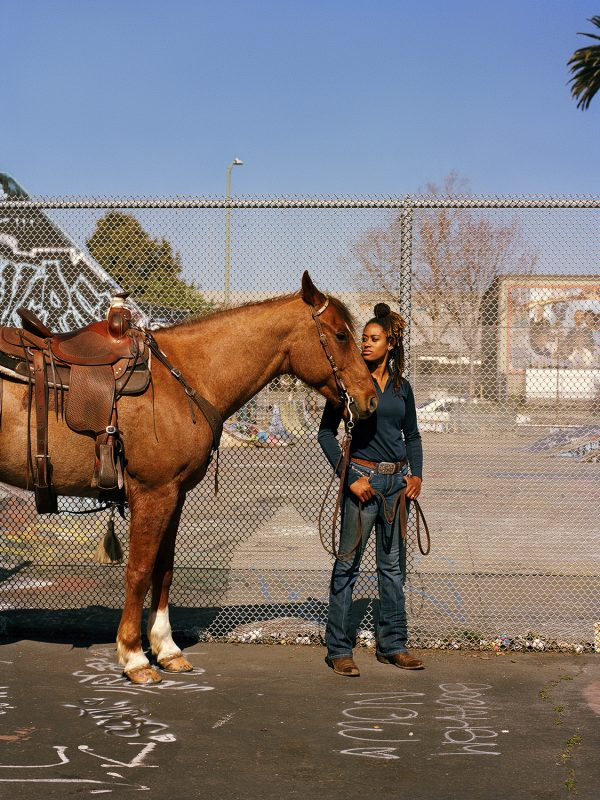 Cowgirl Brianna Noble with her horse Dapper Dan, photographed at Defremery Park in Oakland, California on February 26th, 2021. Bri Noble is the founder and owner of Mulatto Meadows, an equestrian business dedicated to expanding the accessibility of riding and horsemanship to communities historically excluded from the equestrian world. Bri is especially passionate about introducing horsemanship and riding to youth of color and economically disenfranchised populations.